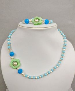 Tiny Closet Flower Design Bracelet & Necklace - Blue