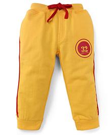 Olio Kids Fleece Track Pants With Drawstring Numeric 32 Print - Yellow