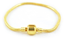 Angel Glitter - Smooth Woven Golde Tone Cylindrical Clasp Metal Bracelet